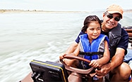 Father and daughter on boat specialty vehicle insurance
