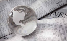 Glass globe paperweight on a newspaper