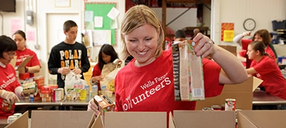 Wells Fargo volunteers assemble packages of food for donation.