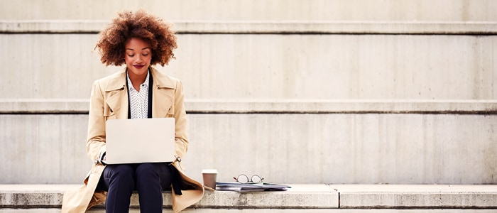 woman on bench with laptop