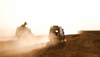 Vans on a desert plain