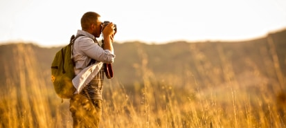 Man in field with camera
