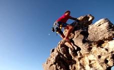 Man climbing a cliff face